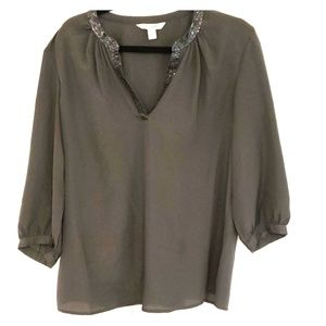 Blouse with sequin neckline